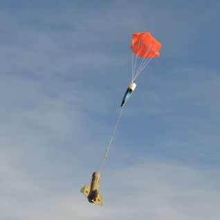 The big orange chute makes it easy to see in the sky